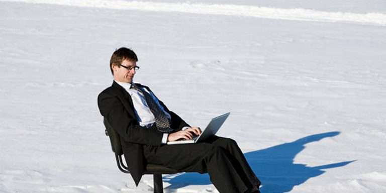 Man working remotely during the snow