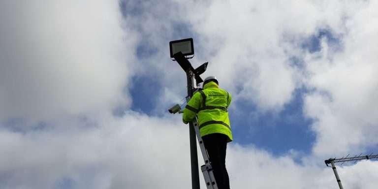 Engineer working on a CCTV camera