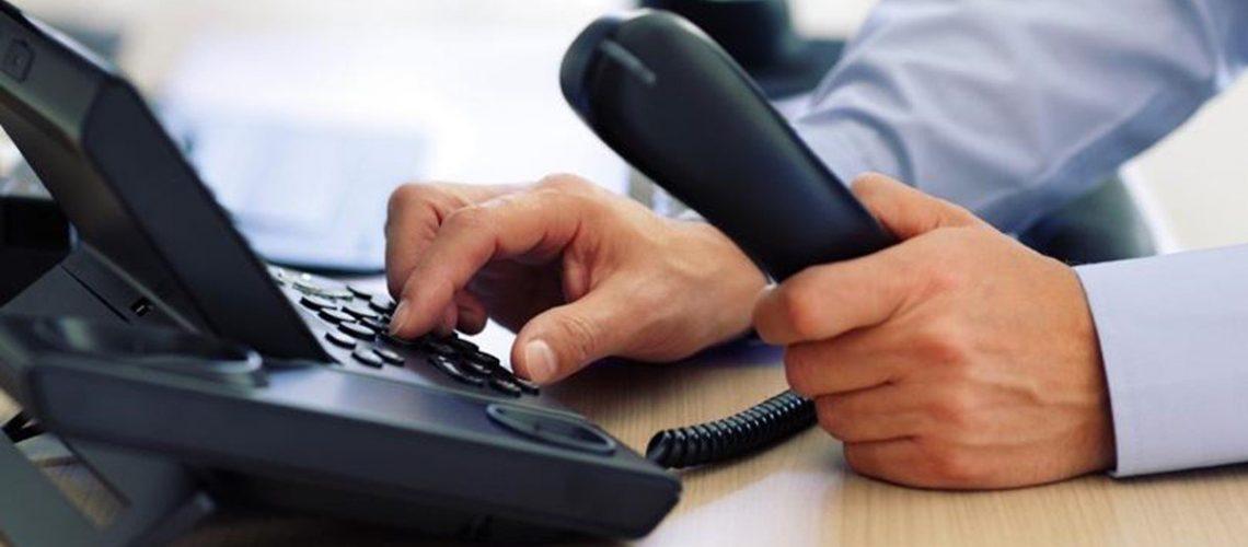 Man using a phone handset